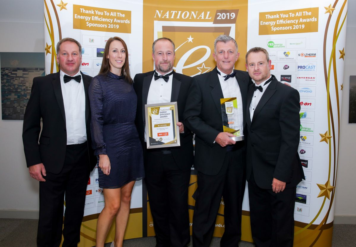 J Tomlinson & Bromford staff celebrate their award at the National Energy Efficiency Awards 2019